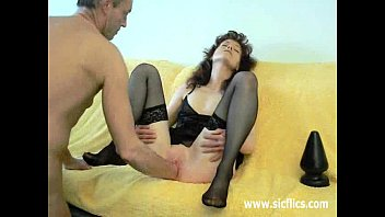 on butt plug strap Romantic couple make sex in the bedroom